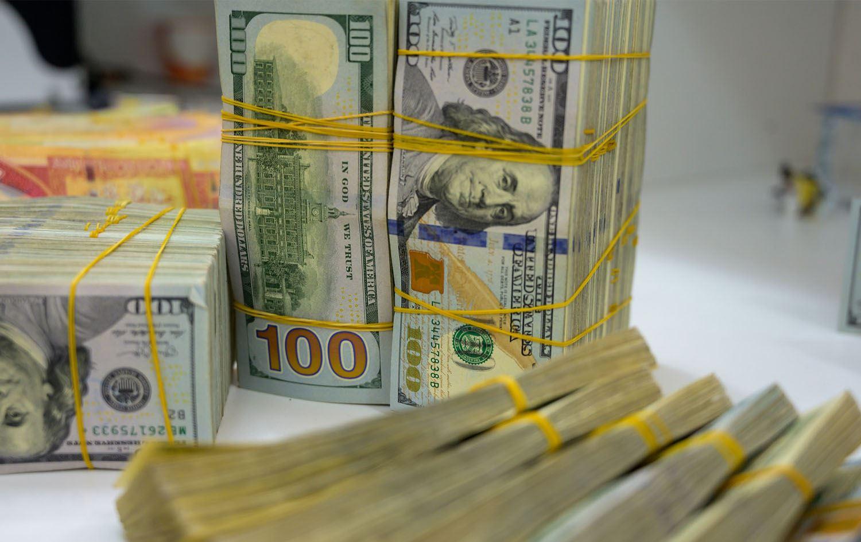 بانكی ناوەندی عیراق: بە رێكاری نوێ بەهای نێوان دینار و دۆلار هاوسەنگ دەكەین